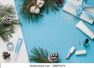 Christmas, New Year blue beauty flat lay frame. Cosmetics top view composition