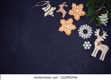 Christmas and New Year border or frame on black background. Winter holidays concept. Greeting template. Top view, toned