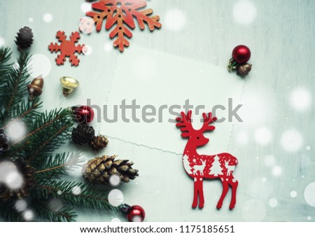 christmas and new year card spruce twigsblank and figures of deers snowflakes