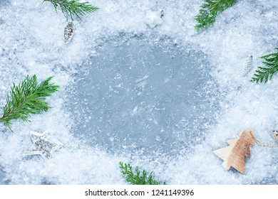 Christmas, New Year celebration concept frame with snow and festive decoration. Top view winter holiday card on the concrete texture. Copy space