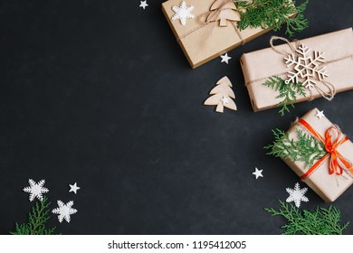 Christmas, New Year celebration, greeting, party concept. Presents wrapped in craft paper with handmade decorations, free space