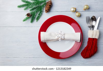 Christmas, New Year celebration place table setting. Wooden background. Copy space. Top view.