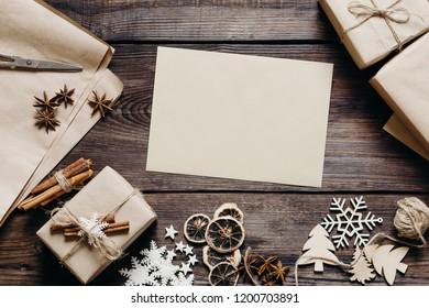 Christmas and New Year celebration. Wish list. Letter to Santa Claus. Creative layout made of festive decorations with paper card note, flat lay. Holidays concept