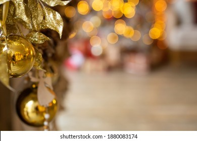 Christmas New Year composition with ball and Toy on Gold background, card for present. Boke. High quality photo