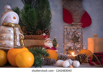 Christmas or New Year composition with a candle, tangerines, and Christmas decorations, pine cones, a place for text. holiday composition of the new year.