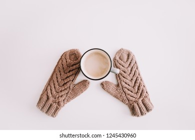 Christmas  New Year composition with coffee mug and knitted mittens isolated on white background. Flat lay, top view. Flatlay, top view, copyspace