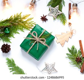 Christmas, New Year concept flat lay with a gift and festive decoration on the white background. Winter holiday composition