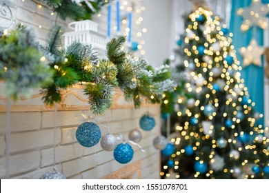 Christmas and New Year cozy living room interior with decorated firtree, fireplace and garlands bokeh