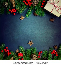 Christmas or New Year dark background, Xmas black board framed with season decorations, space for a text, view from above