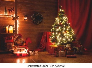 Christmas and New Year decorated interior room. Holiday decorated room with bed on window sill. Festive Xmas night with lights on tree with presents. Magic night with gifts