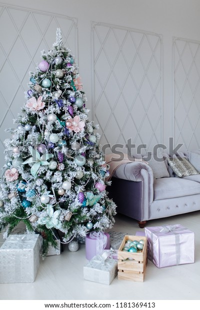 Christmas and New Year decorated purple interior room with presents and New year tree and sofa
