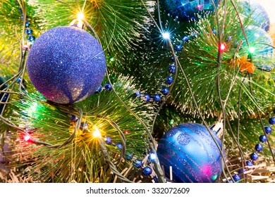Christmas and New Year Decoration. Christmas ball hanging on a Christmas tree. Bright garlands