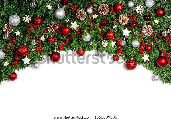 Christmas New year decoration frame isolated on white , fir tree branches , red and silver baubles and pine cones , copy space for text