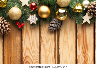 Christmas or New Year decoration on wooden background and space for a text