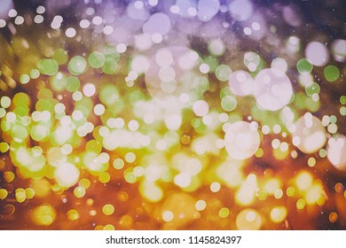 Christmas and New Year feast bokeh background with copyspace. Holiday party background with blurry boke special magic effect.