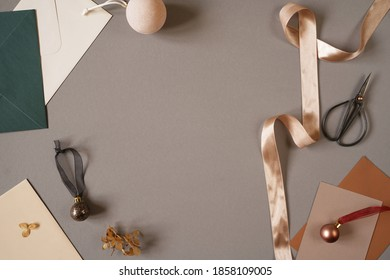 Christmas, New Year festive composition with blank space for text and ribbon, cotton wrapping paper ornament on dark grey moody background. Trendy elegant photo for social media text announcements. - Shutterstock ID 1858109005