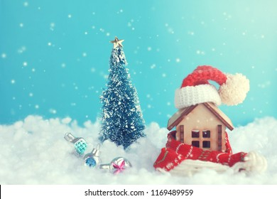 christmas, new year festive greeting card, small house with scarf and hat in snow, fir tree, baubles, vintage stile