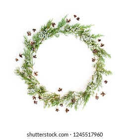 Christmas, New Year festive mock up made of evergreen plants and natural cones. Flat lay. Top view