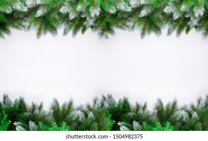 Christmas or new year frame of spruce, christmas decorations on white background. Copy space. Winter holidays, New Year.