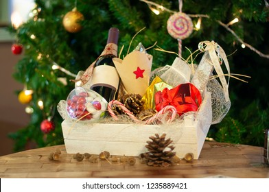 Christmas and New year gifts and baskets with sweets, alcohol, chocolate and cookies