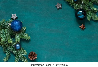 Christmas, New Year green wooden frame. Winter holiday concept flat lay. Top view. Copy space