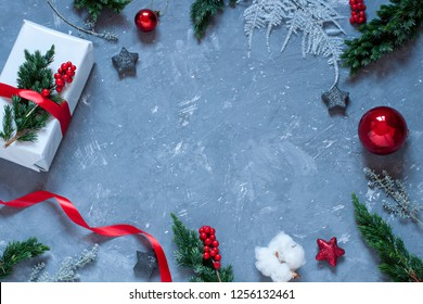 Christmas, New Year greeting card frame on the concrete texture background. Winter holiday concept flat lay. Copy space