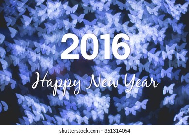 Christmas and New Year greeting card on blue butterfly light bokeh background, 2016