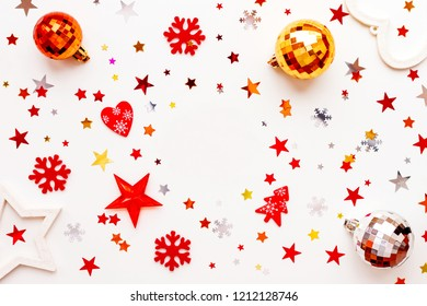 Christmas and New Year holiday background with decorations and clear round background in center. Shiny balls, felt snowflakes and star confetti. Flat lay, top view.
