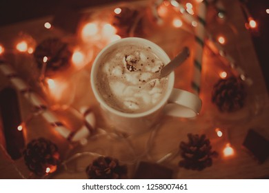 Christmas, New Year holiday background. Winter hot Christmas coffee or chocolate or cocoa with marshmallow with decorations.