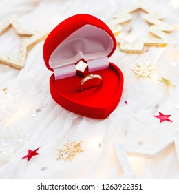 Christmas and New Year holiday background with decorations and engagement ring in gift heart box. Valentine's Day card.