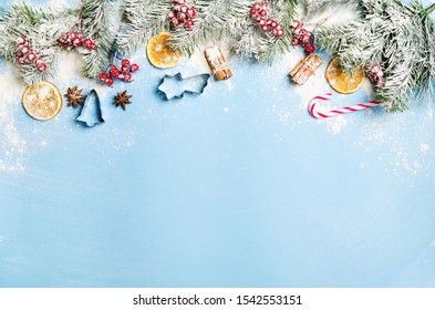 Christmas and New Year holiday background. Xmas greeting card. Christmas accessories on blue background top view. Flat lay