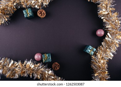 Christmas New Year holiday dark background ornaments garlands tinsel from above