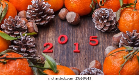 Christmas And New Year Holiday decoration.Tangerines, cones and nuts.