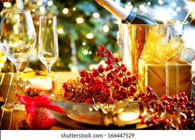 Christmas And New Year Holiday Table Setting with Champagne. Celebration. Place setting for Christmas Dinner. Holiday Decorations. Decor. Served Table