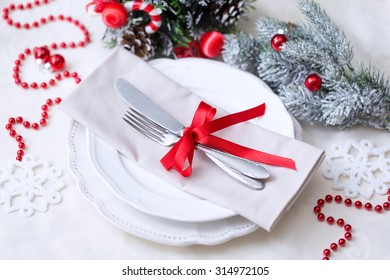 Christmas And New Year Holiday Table Setting. Celebration. Place setting for Christmas Dinner. Holiday Decorations.