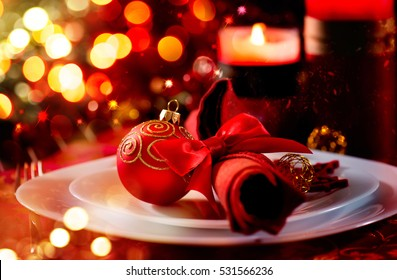 Christmas And New Year Holiday Table Setting. Celebration. Place setting for Christmas Dinner. Holiday Decorations. Xmas Decor