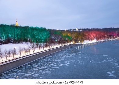 Christmas (New Year holidays) decoration in Moscow (at night), Russia-- Vorobyovskaya Embankment of the Moskva river and Sparrow Hills (Vorobyovy Gory)