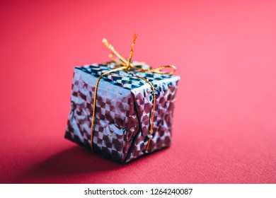 Christmas New Year Holidays gift box on red pink background close up shadows