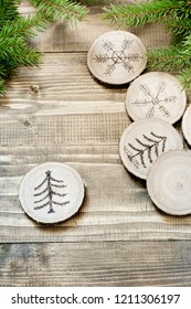 Christmas or New Year homemade pyrography toys. Wooden slice. Alternative decor. Christmas decorations. Close up.