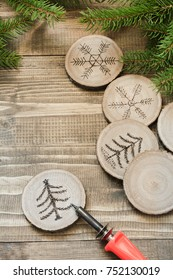 Christmas or New Year homemade pyrography toys. Alternative decor. Christmas decorations. Close up. DIY.