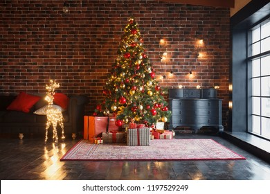 Christmas, New Year interior with red brick wall background, decorated fir tree with garlands and balls, dark drawer and deer figure - Shutterstock ID 1197529249
