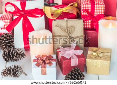christmas or new year party theme gifts presents boxes collection with pine cones and decorations