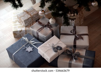 Christmas new year presents lying under Christmas new year tree