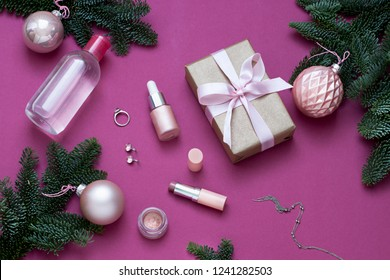 Christmas, New Year purple beauty flat lay. Cosmetics top view composition