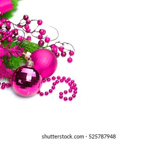 Christmas and New Year purple color Decoration isolated on white background. Border art design with holiday baubles. Beautiful Christmas tree closeup decorated - ball, holly berry, tinsel. Copyspace