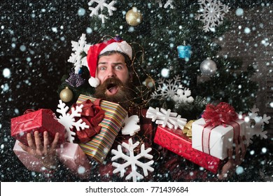 christmas new year snow concept Winter holiday and xmas. shopping and party celebration. Santa claus man with present box at christmas tree. Christmas man with beard scared face hold gift. boxing day