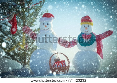 551456af1a5f3 christmas new year snow concept New year snowman from snow in hat. Xmas or  christmas