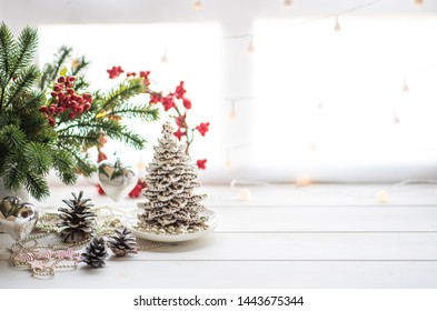 Christmas or new year still life with ornaments on rustic white table. Christmas cookies with festive decoration. Homemade gingerbread. Winter decoration background. Copy space for text.