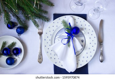 Christmas or New Year table decoration in white and blue colors.