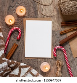 Christmas and New Year template for greeting card with candy canes, cinnamon sticks and candles. Square mockup with vertical blank sheet of paper